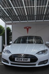 White Model S under the Solar Canopy
